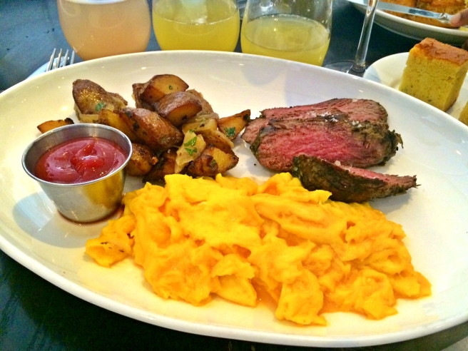 [Steak and eggs with belinis and mimosas]